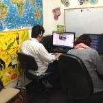 Students studying English in the computer lab at King Eikaiwa in Kizugawashi